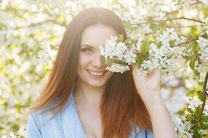 Cute girl in apple blossom
