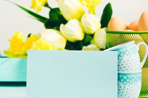 Happy Easter pastel green yellow background tulips card