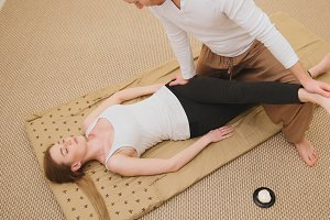 Medical thai massage - caucasian model female - stretch the muscles