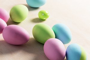 Pastel Easter eggs on wooden table.