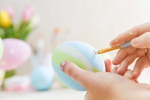 Easter eggs handicrafted with pastel stripes.