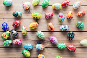 Easter handmade eggs on wooden table.