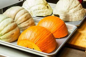 Squash and pumpkin halves on tray
