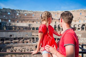 Back view of young dad and little girl in Coliseum, Rome, Italy. Family portrait at famous places in Europe