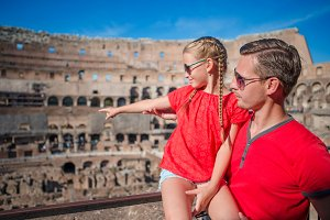 Family tourists in Coliseum, Rome, Italy. Family portrait at famous places in Europe