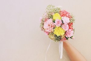 Bouquet of flower in hand