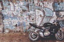 Motorcycle and Graffiti Wall