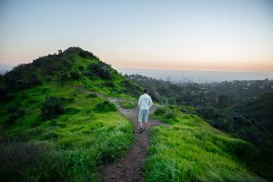 Tourist man walking on trail