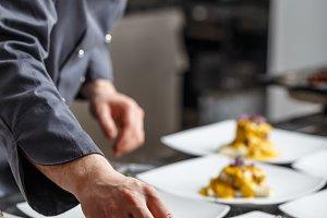 Young chef prepares delicious meals
