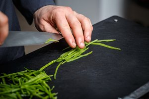 Chef cutting green peas