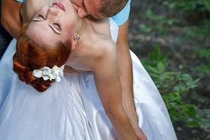 Passionate Wedding Kiss