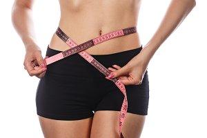 Girl measures the waist