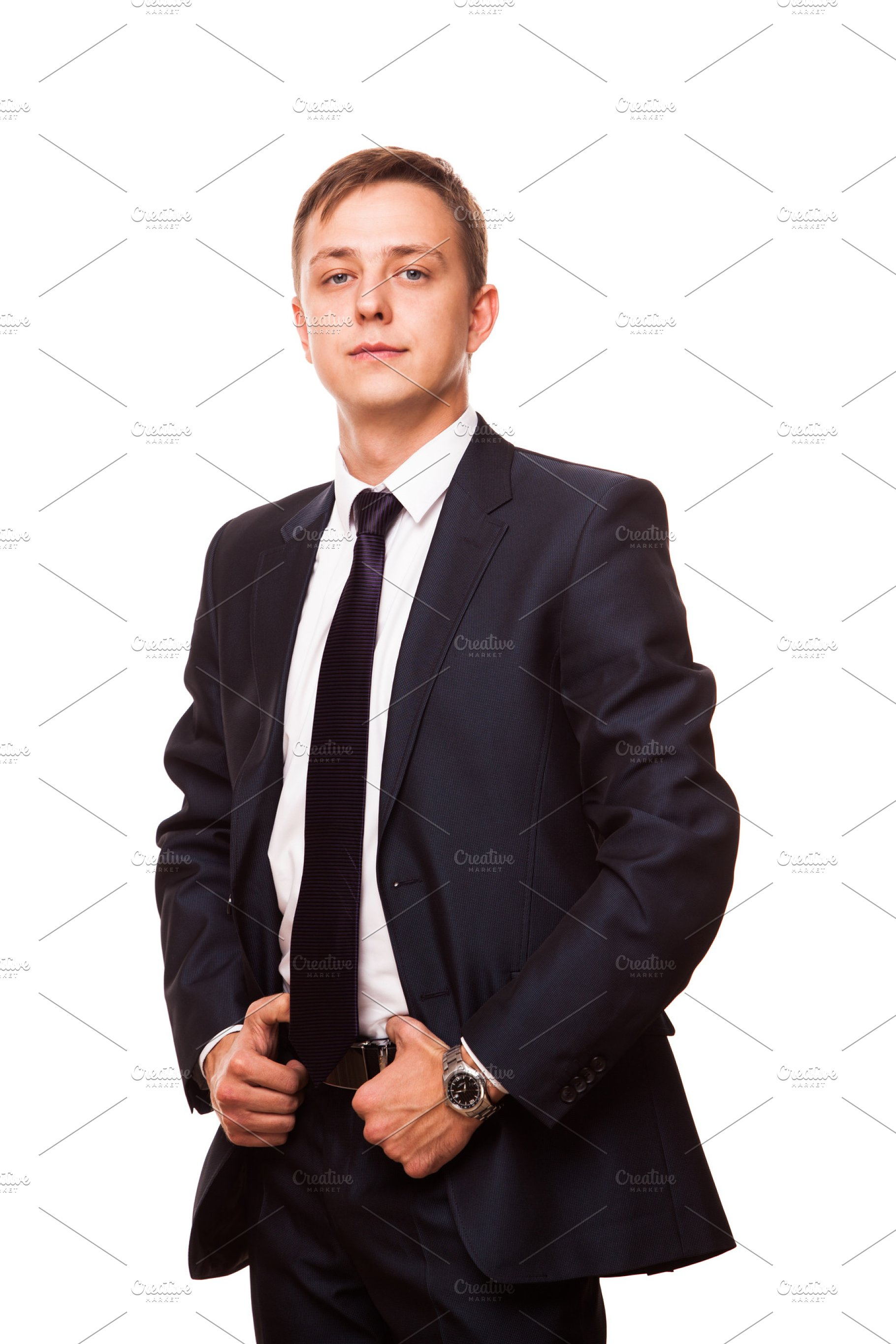 ab72778b3b Save. Young handsome businessman in black suit is standing straight, full  length portrait isolated on white
