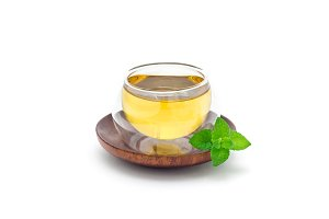 Healthy herbal mint tea in oriental glass cup isolated on white background, horizontal