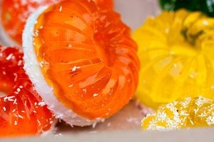 Fruit jelly cake on the market close up. Selective focus