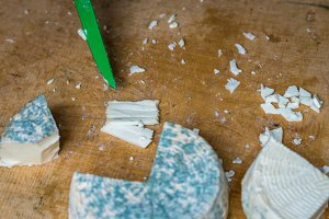 pieces of cheese with blue mold