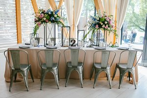 Festive table with compositions of flowers