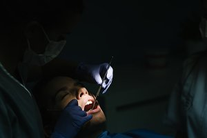 Dentists with a female patient.