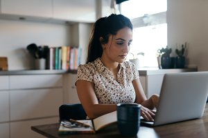 Young woman working at laptop