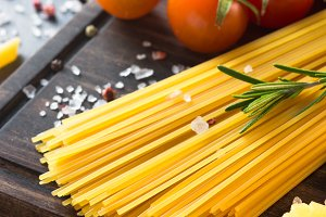 Raw Italian pasta spaghetti and cooking ingredients