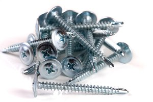 pile of metal screws isolated on white background