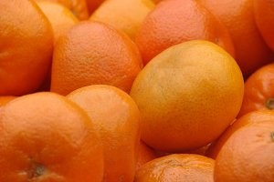 tangerines on the market for sale as a background. Selective focus