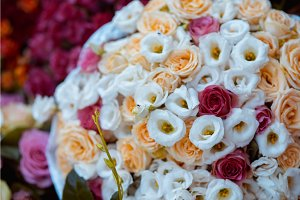 close up on white and red roses wedding bouquet top view