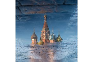 St. Basil's Cathedral on Red square in spring day reflected in the puddle. Moscow, Russia
