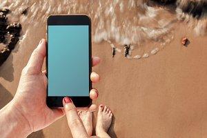 Blank mobile screen on da beach