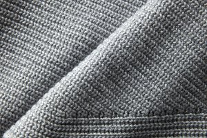 gray knitted jumper material texture