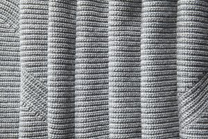 full page of a loose gray knit fabric texture