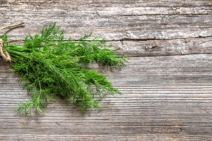 Dill herb on wooden background