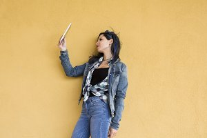 young hipster woman with tablet
