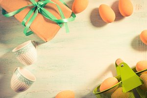 Happy Easter pastel green background eggs gift cups space