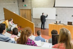 Male teacher with students at the lecture hall