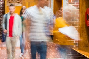 Blurred students walking through corridor