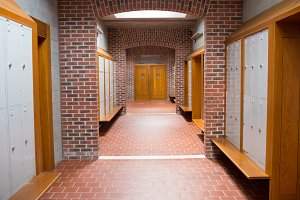 Brick walled corridor with tiled flooring in college