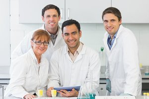 Smiling scientists with tablet PC in the lab