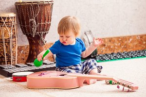 Boy with musical instruments