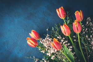 Tulips bouquet on dark background invitation greeting card