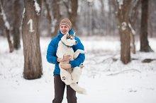 Man holding a puppy