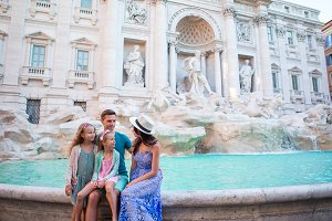 Family near Fontana di Trevi, Rome, Italy. Happy father and kids enjoy italian vacation holiday in Europe.