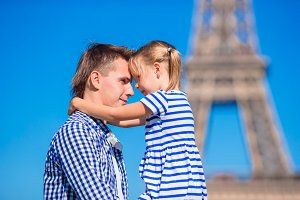 French summer holidays, travel and people concept - happy family in Paris background Eiffel Tower