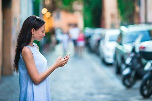 Woman in Rome with selfphone on vacation travel. Smiling happy girl having fun during holidays in Rome