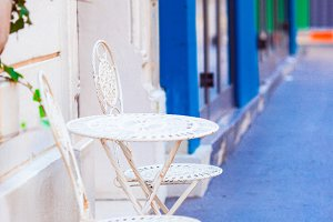 Two blue chairs on a street of italian traditional village in Italy