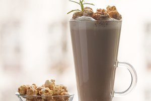 Glass of coffee with popcorn