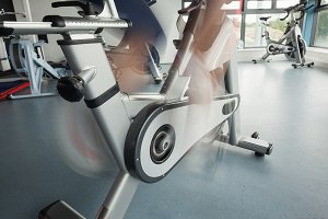 Low section of a determined woman working out at spinning class