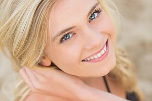 Overhead Close up portrait of smiling blond at beach