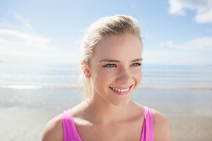 Smiling healthy woman on beach