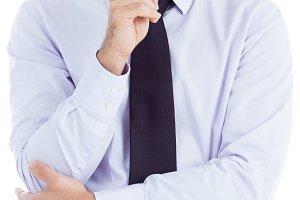 Thinking businessman holding glasses